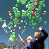 Aprill McKinley, right, and Tommy Mitchell, in blue, both of SHHS, join in with other students for a balloon release in memory of Seth Rogers, a 19 year-old who died of leukemia. The release was part of a day-long affair at the Courthouse Athletic Club Saturday benefitting the Because I Care Foundation. Matula photo.