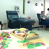 Beads and king cake lay on the desk because of Fat Tuesday, while Rena Fields, a Phlebotomist, gets blood from Milton Evans, Tuesday afternoon at Stewart Regional Blood center in Longview. Kevin green