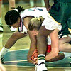 KC's #24 battles for the loose ball with San Jacinto's #32 during Saturday night's game in Kilogre. kevin green