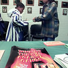 Justin Pringle, 11 left, signs in with WOHS 4H student Brokke Snoddy, 15, at a Gregg County drug and gang seminar at the county service center Thursday, 1-22. Matula photo.