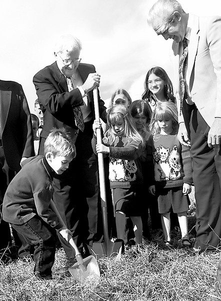 Six year old Gary Duncan of Springhill Kindergarten gives a hand in the Ground Breaking Ceremony as  Carroll Phillips left and twins Caryn  and Cannie Esch center, assist.  David Capps right, looks on at the Pine Tree Church of Christ Ground Breaking Ceremony Sunday. Obie LeBlanc