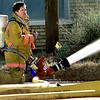 Longview Firefighter mans a hose while battling a fire at T & P Hotel Saturday morning in Longview. Darlene