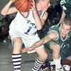 Trinity's #14 gets the rebound as Boles' #42 reaches in to attempt the steal Friday night. Matula photo.