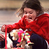 "Kelly Nichols, 5, is shocked by her doll, Casey Cartwheel's, ""unmentionables"" after taking the doll to St. Mary's school for show 'n tell. Kelly was waiting for her ride home from school. Matula photo."