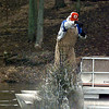 Jessie Jordan throwns another tree into Lake Lone Star Tuesday. The Chamber and the Texas Parks & Wildlife Dept. collaborated to take Longview's Xmas trees and make them into a habitat for cover-dwelling fish. Matula photo.