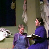 Wiley, left, played by Don Martin, listens as Mammy, right, played by Jenna Stanley, reads from her book, during New Diana Middle School's one act play Wiley and The Hairy Man Tuesday night at New Diana. Kevin green