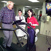 B. J. Kirkpatrick works out on a treadmill as Dr. James Stock, center, the co-investigator for the Sprint project, and Cynthia Boudreaux, right, in clinical research, look on Thursday morning at the rehabilitation center at UT Health Center in Tyler. Kevin green