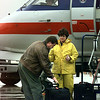 An American Eagle bagge handler checks a passenger's bag before the plane leaves for DFW. Matula photo.