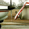 A Cessna 150 owned by Bird King of Tyler, lays overturned against a hanger at the Upshur County Airport Tuesday morning in Gilmer, after a storm went through the area Monday night. Kevin green