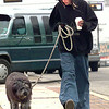 Pat (Dopey) McCuait walks with Chewbacca his dog as they go to the mall Thursday afternoon on East. Marshall in Longview. Kevin green