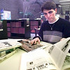 Nathan Clark, looks over some books about Israel at Longview High School in the library. Kevin green