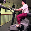 Anthony Montes, of Longview, works out as he watches CNN at Parke Way Family Fitness Center Wednesday afternoon in Longview. Kevin green