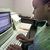 Date:   7/1/98----DaRaesha Owens,11, works with a music program on a computer Wednesday afternoon at Pinewood Park Elementary in Longview. Kevin green