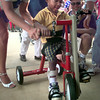 7/23/98---LaDarius Charles, 2, grandson of Charlene Charles, excitedly tries out his new tricycle that was donated by AMBUCS women's club in a ceremony at Rotary  Park in Longview Thursday evening.  Jessica Williamson