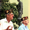 Date:   7/4/98--Evelyn Perkins, left, a former pow of the Korean and a member of VFW post 4002, and Wayman Reynolds, right, also with VFW post 4002 aplauds during Congressman Ralph Hall's speech during ceremonies Saturday morning on the Gregg County Courthouse lawn in Longview. Kevin green