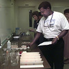 Date:   7/14/98---Floyd Robinson, Jacksonville ISD, collects his materials needed to participate in the Ozone education workshop hosted by Texas Eastman Tuesday. Teachers from around the area participated in the one day workshop to become better prepared to instruct their students on problems of ozone pollution. Jessica Williamson