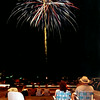 07/04/98---Left to Right---Brian Gillespie, 13, left, of Beaumont, Tricia Lawson, David Lawson, and in dad's lap is daughter Emily,5, all of Longview, Brian is David's nephew, enjoy the Fourth of July fireworks at Longview Fairgrounds Saturday night in Longview. Kevin green