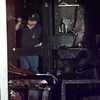Date:   7/4/98---Longview Fire Marshal Bob Barker investigates a fire on Lake Dr. late Saturday night in Longview. kevin green