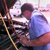 Date:   7/21/98---Dennis Combest, a mechanic at East Texas Air and Glass, repaires a vehicle's air conditioner on a hot Tuesday afternoon in Longview.  Jessica Williamson