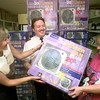 Date:   7/20/98---Becky McJunkins, left, spokeswoman for SWEPCO, and Capt. Gene Tharp, center, with the Salvation Army, present one of the first fifty fans donated by SWEPCO and Target to Doris Roberts, right, of Longview, Monday afternoon. The fans will go to the ederly and the disabled with no cooling first. Kevin green
