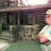 Date:   7/1/98---Audie Irvin the Lead Ranger at Caddo State  Park stands in front of cabin with AC at the park in Karnack. Kevin green