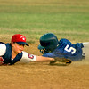 Date:   7/7/98----Marshall's second baseman #11 Scott Adair, left, tags #5 Zane Hendon, right, with Longview, out at second durign action Tuesday evening at McWhorter Park in Longview. Kevin green