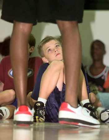 Date:   7/28/98---Camper ????? Joe has name looks up to Cedric during a talk at the David Wesley Basketball Camp Tuesday afternoon at Lobo Colisium in Longview. Kevin green
