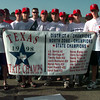 Date:   7/30/98---Longview American team proudly displays their 1998 Texas State Champs banner before leaving for Alabama and the Dixie Boys World series.  Jessica Williamson