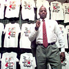 Date:   7/8/98----Warren Hearne stands in front of a display of his designed t-shirts Wednesday morning at Pro's Choice in the Longview Mall. Kevin green