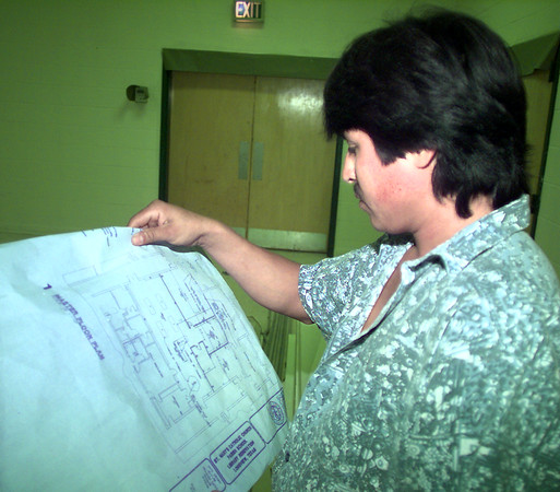 Date:   7/23/98---Jose Salnas, employee of Satanta Enterprises, looks at the blue prints of the new library of St. Mary's Catholic School.  Jessica Williamson