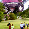 07/17/98----A LPD motorcycle officer makes his way through a field at the St. Michael & All Angels episcopal church in the 900 blk. of Reel Rd.  as onlookers gather as the monster truck hot-air balloon gets trapped in the power lines while attemping to land Fridfay morning in Longview. Karen Green