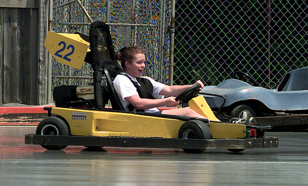 Date:   7/21/98---Liza Christian,13, with First Baptist Church in Center rides on the slick track Tuesday afternoon at Fast Track. Kevin green