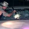Date:   6/26/98---DPS Troopers Rodney Tandy, left, and Bob Powell, right lokk at the windshield of the carafterA 30-year-old Longview woman was hit Friday night after being hit by a car while walking down the middle of the Texas 31 west across from Pancho's Restaurant, according to a report from Department of Public Safety Trooper Scott McAdams. The occupants of the 1991 Chevrolet Beretta involved in the accident were unharmed.  Kevin Green