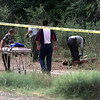 Date:   6/17/98---LPD detectives investigate the body of a homeless man found behind Lillies Lounge a closed down honky-tonk on West 80 Wednesday morning in Longivew. Kevin Green