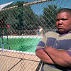 Date:   6/2/98---James Alford-15, stands outside the fence where he pulled a drowning boy from Ingram pool in Longview. Kevin green