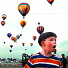 An unidentified kid expresses disbelief as baloons launch for the Saturday night race. Chris Matula photo.