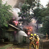 Date:   6/5/98---Longivew firefighters try to get a blaze uder control at 314 W. Kenwood Friday afternoon in Longview. Kevin green