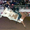Date:   6/12/98---Johnny Moffett of Gruver,TX. rides War Paint during the Gladwater Round-Up Rodeo in Gladewater.Kevin green