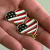 Date:   6/11/98--American Flag ear rings sell for about four dollars at Dreesin's Gaudy in Longview. kevin green