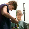 Date:   6/6/98---Wayne Williams,14, left, helps Ashley Dyson,10, right, his sister by taking her fish off during the kids fishing tourney Saturday afternoon at Martin Creek Lake. Kevin green