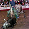 Date:   6/12/98-Time:   20:45:29---Eli Thompson from Seagoville,TX. rides Bandelero during Friday night's bull riding competition at the Gladewater Round-Up Rodeo in Gladewater. Kevin green