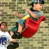 Date:   6/24/98----Uriel Sanchez,the four year old son of Filimon and Adela Sanchez of Longview enjoys his swing ride Thursday morning in the 1200 blk. of South High St. in Longview. Kevin green