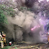 Date:   6/5/98---LFD firefighters work to control a house fire in the 300 blk. of Kenwood St. Friday afternoon in Longview. kevin green