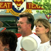 Date:   6/30/98---Bill Gray, left, and Michelle Thomason, right, both with TransWestern Publishing, take time to fan during the Longview Partnership's June Great Texas Balloon Race mixer Tuesday evening at the Longview Mall. Kevin green
