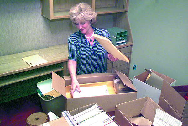 Date:   6/18/97---Chris Hancock, secretary to the assistant superintendent for KISD, unpacks boxes in the new administration building at 301 N. Kilgore St. Thursday afternoon in Kilgore.  Jessica Williamson