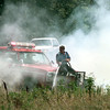 Date:   6/22/98---A Kilgore firefighter sprays water from the firetruck Monday afternoon as they try to contain several grass fires in the median on Texas 31 in between Longview and Kilgore. Kevin green