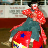 Date:   6/12/98----Quail Dobbs sits on this barrell as he gets ready for the bull riding competition Friday night during the Gladewater Round-Up Rodeo in Gladewater. kevin green