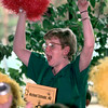 Date:   6/3/98--Debbie Smith cheers on the Michael Schindel, M.D., spelling bee team Wednesday afternoon during the East Texas Literacy Council spelling bell at the Michelob Room in Longivew. Kevin green
