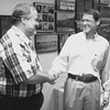 Tom Wilcox left shaking hands with Tim Sonnenberg at a  reception held White Oak School Sunday. Obie LeBlanc.