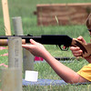 Date:   6/17/98---James Fincher,10, trys his hand at the BB gun range during the day camp for cub scouts at Pine Tree Junior High Wednesday afternoon in Longview. kevin green